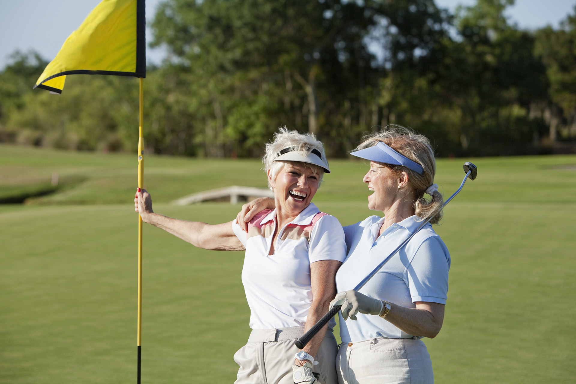 Ladies' playing golf at Addison Reserve in Florida