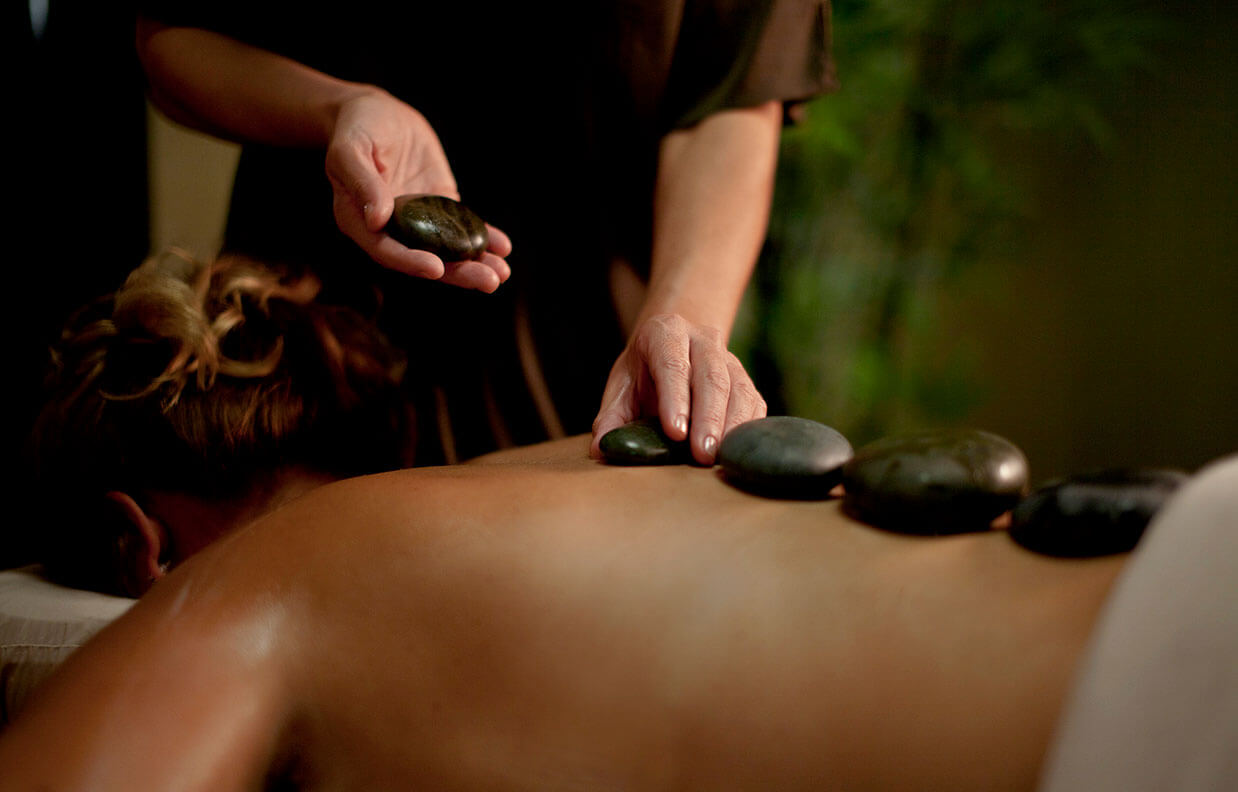 Woman getting stone spa treatment at Addison Reserve in Florida